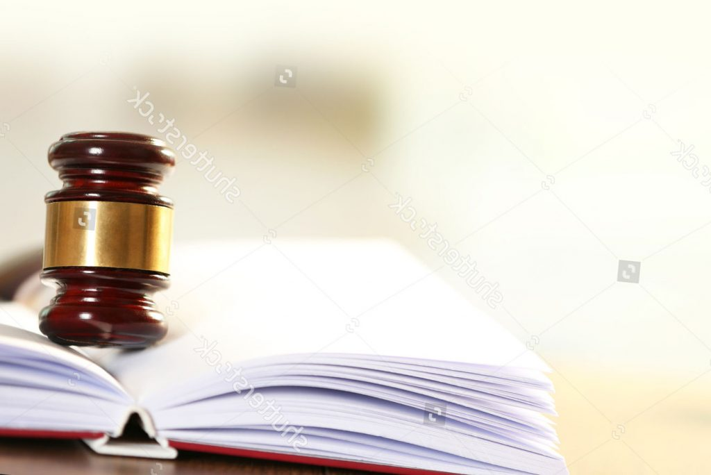 stock-photo-wooden-judges-gavel-lying-on-law-book-close-up-244744654